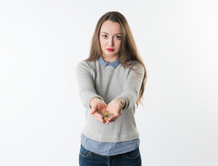 Image of woman holding out coins
