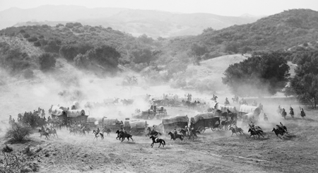 Photo of a wagon train crossing America