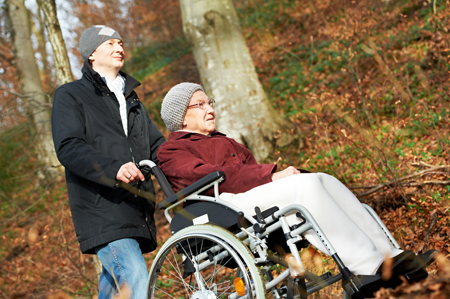 Photo of Man pushing woman in wheelchair