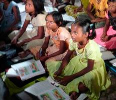 School girls attending class