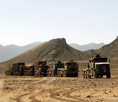 Military convoy ferrying supplies across desert