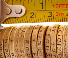 Pound coins and a tape measure