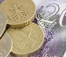 British pound note and coins