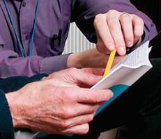 People examining leaflet