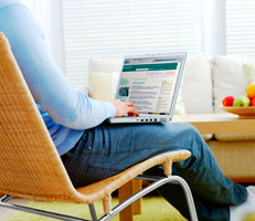 Seated person using a laptop