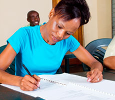 Student completing an application form
