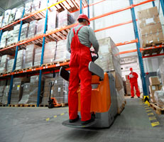 Man in warehouse moving stock