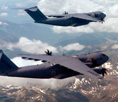 Two Hercules aircraft in flight