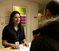 Jobcentre official talking to customer