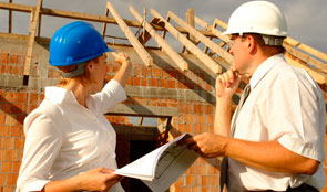 Engineers discussing house build in progress