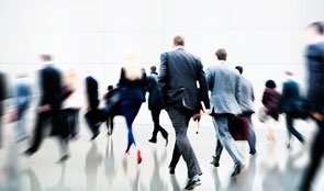 Blurred image of office workers walking