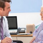 Elderly patient in consultation with doctor