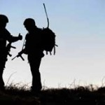 Silhouette of two soldiers