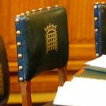 Chair back with portcullis emblem