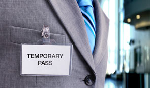 Man wearing a temporary pass badge