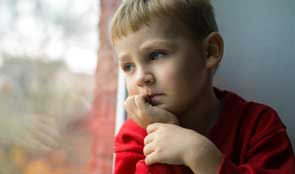 Child gazing out of window