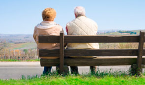 Pensioners sitting on a bench