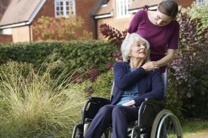 Patient in wheelchair with carer