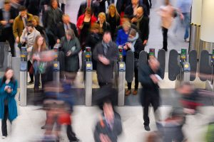 Passengers at a ticket barrier