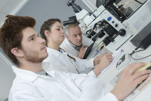 Scientists with microscope