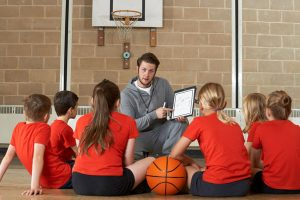 Gym teacher with young pupils