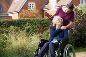 Lady in wheelchair with carer
