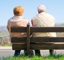two pensioners sitting on a bench